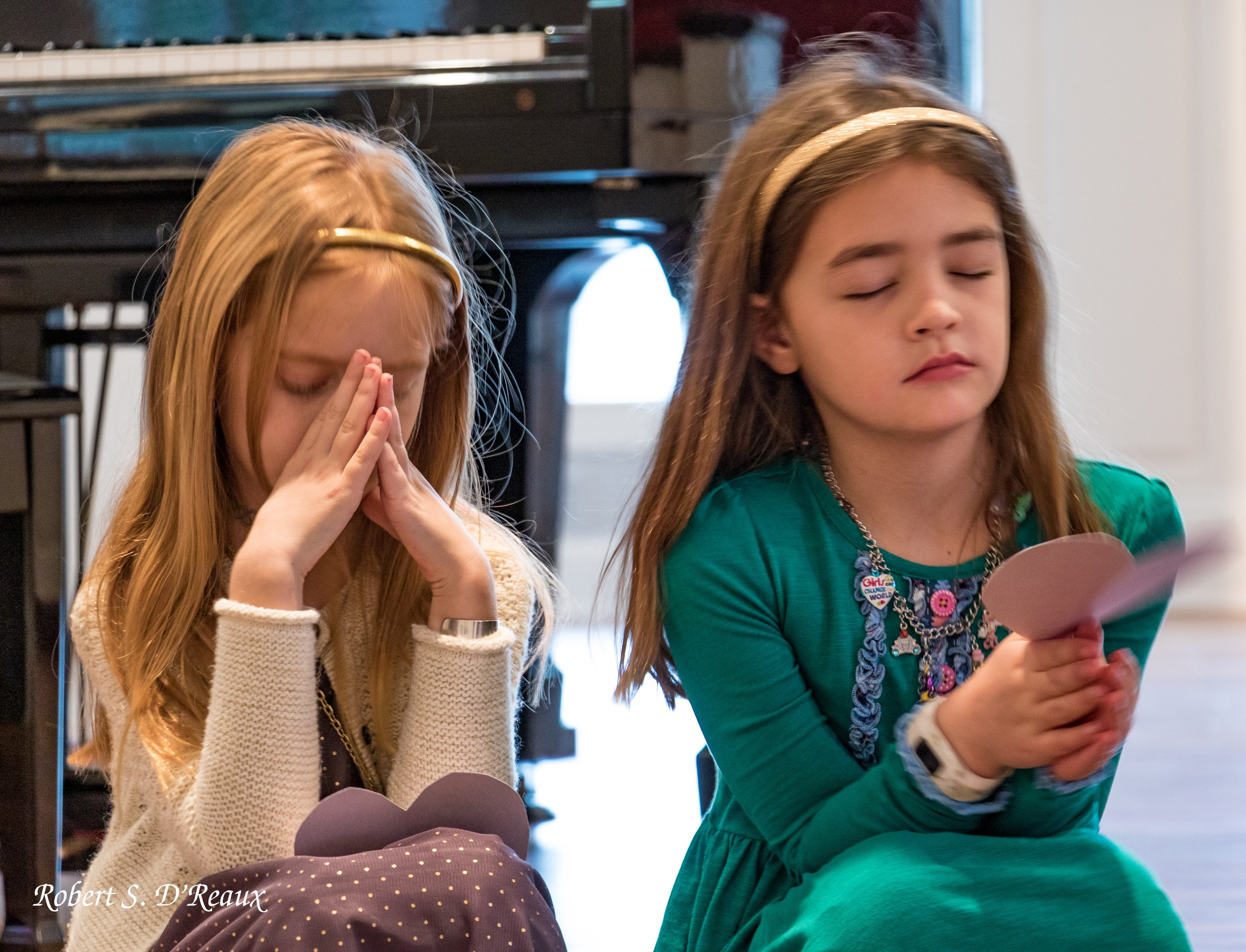 Girls Praying at Worship